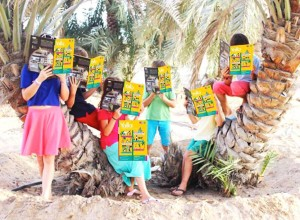 Children enjoying the latest edition of Yalla - the know it all guide for families in Abu Dhabi. Interview with founder & CEO Jane Barraclough & Tamsin Anderson | Expat Entrepreneurs | OurGlobetrotters.Net