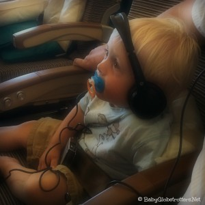 Toddler Travel Mistakes - make sure to use headphones on a plane - if they'll kep them on! | OurGlobetrotters.Net