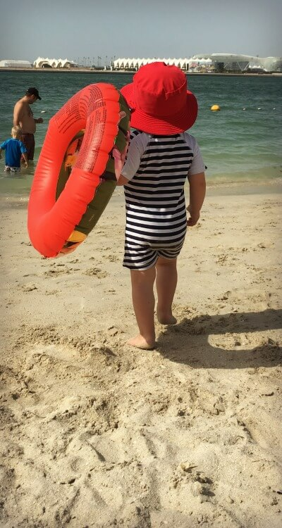 Baby in Snapper Roack UV Sun Suit | Summer sun protection for babies | OurGlobetrotters.Net