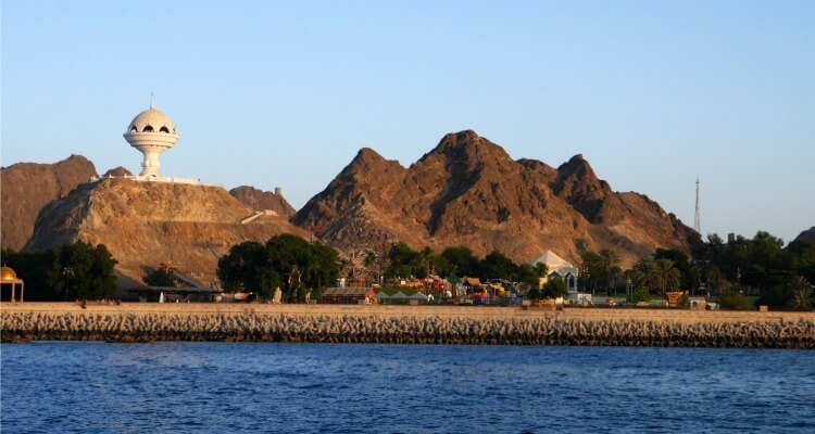 Planning an Oman road trip | View from Muscat harbour of Al Riyam Park and the incense burner statue