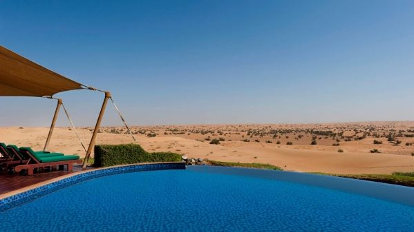 view of the pool over the desert at Al Maha Desert Resort and Spa